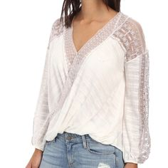 """Free People Valley City White Top NWT White flowy top with mauve lace detailing. Pair with bell bottom jeans and leather sandals and you're set!  Fiber Content: 41% cotton/31% rayon/28% polyester    Fit is true to size. Measurements: bust 32"""", waist 25"""", hips 34"""".  No Trades Free People Tops Tunics"""