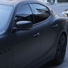 Maserati Quattroporte with matte black wrap with gloss trim, logo and accents. Matte Black Wrap, Maserati Quattroporte, First Time Driver, Custom Wraps, Best Car Insurance, Exotic Cars, Vehicles, Vehicle