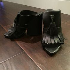 Fashion forward black leather mules with tassel Chunky block heel, mid-size, black leather, worn only a handful of times, tons of compliments! Zara Shoes Heels