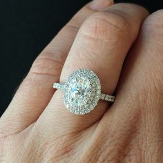 THE PERFECT RING! This oval diamond with a double halo is so pretty! I'm in love!