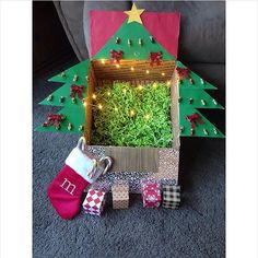 ADMIRE from @tinawhatt: Christmas care package! Tree, stocking, lights and mini presents to boot!