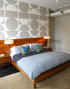 Drooling over the custom FlavorPaper-wallpapered accent wall in this impeccably-designed loft. Check out DomesticDaddy via the link to see more of this NYC loft bedroom reno: behind that geometric accent wall and bed is an amazing custom closet solution, too!