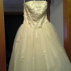 Wedding Dress or Ball Gown Color is light yellow. Pics do not show how pretty and unique this is! Never used : (  Only worn to seamstress. I lost too much weight (size 4) and couldn't alter it to fit me. There are a few small cuts inside of dress where seamstress was trying to see if she could alter it. A few beads missing at bust area which are not noticible because of details. 3rd, 4th pic shows example of beading. Laying flat approx 14 1/2 inches  at waist x 52 inches long.  Please ask…