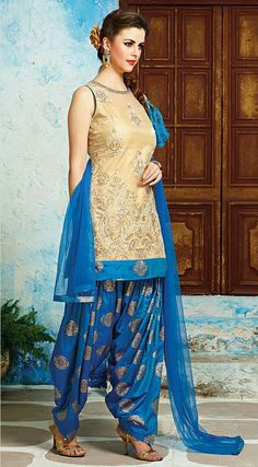 Beige net patiala suit with resham embroidered foliage patterns and motifs with stones spread all over the suit