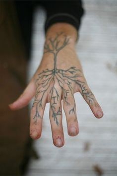 Very painful to get a tattoo on the hand because of all the nerves and how thin the skin is. Tree hand tattoo.