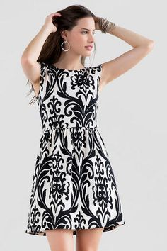 """The Katella Printed Dress is perfect for any season!  A black & white medallion print covers this stretchy textured dress finished with cap sleeves.  Finish off your look with a statement necklace & heels.<br><br>   -34"""" length from shoulder to hem <br> -28"""" chest<br> -22"""" waist<br> -50"""" sweep<br> -Measured from a size small<br><br> -98% Polyester, 2% Spandex <br> -Hand Wash <br> -Imported <br>"""
