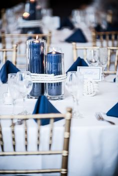 No roping but navy columns in the glass tubes could add navy to some of the decor areas