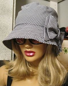 Houndstooth Cloche Hat ....... Kinda creepy to have such a thing in my pin board but its just too ugly n can't resist pinning