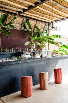 Outside bar area? Ceiling design, black bar, and stools- very tropical - all that jazzzzz
