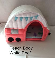 This is a Fleece Travel Trailer Pet Hide Home. Perfect for your Hedgehog or Guinea Pig. It measures approx 11-12 wide ( not including the hitch) ..it is 11-12 (30.48 CM) tall and 8 (20.32 CM)wide. It comes with a liner pad with travel trailers on it. **This is a custom order item. My order time is about 2.5 weeks*** Made of fleece sewn with batting in between the layers. You choose the color of the trailer lower body. And the color of the roof and upper body of the circa 1960 Travel…