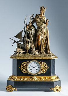 Reloj de sobremesa en mármol, calamina y bronce dorado, con grupo escultórico, que hace alusión a la Revolución Industrial. Trabajo francés, mediados del S. XIX / Alcalá Subastas
