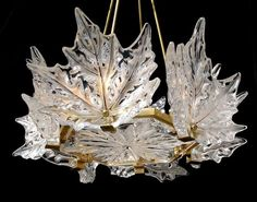 Rene Jules Lalique, the French glass designer known for his creations of perfume bottles, chandeliers, clocks and even automobile hood ornaments started a Art Nouveau, Art Deco, Lalique Jewelry, Crystal Centerpieces, Vintage Chandelier, Bubble Chandelier, Chandelier Lighting, Antique Lamps, Crystal Jewelry