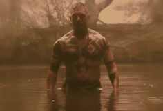 Menacing: in a new official sneak-peak for the up-coming FX show Taboo, Tom Hardy has stripped off once-again to showcase his hulking physique and menacing character