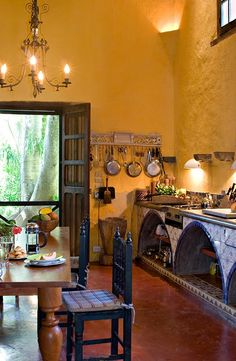 I remember being a child and following in love with this type of Hacienda kitchen in a house called casa de colores.