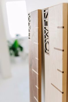 Modern solid Maple growth chart with inlaid Walnut tick marks every three inches. This beautiful growth chart is personalized with the name of your choice There are no numbers, so this piece can lean against the wall or hang at any height with the pocket keyhole located on the top