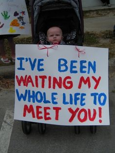 baby waiting to meet his daddy for the first time when he comes home from the war!