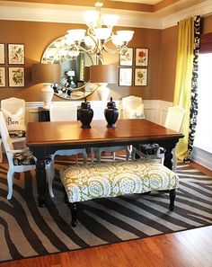 Im not a dining room person. But this is gorgeous! Love the rug, the window treatment, the BENCH!! so creative. AND that big mirror. Could do without the HUGE lamps on the back table but all in all - I love this room.