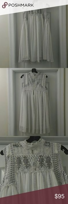 SALE🎉NWOT Free People Victorian Inspired Dress New without tags Free People Victorian Inspired mock neck embellished chiffon and lace dress. Shades of lavender and purple mixed with white. Lovely pastels. Printed stripe pattern on skirt portion. Beaded embellishment at neckline. Trapeze swing style silhouette. Flattering, comfortable and uber feminine. Open to offers. Free People Dresses