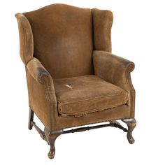 Brian Suede Chair at Found Vintage Rentals. Worn armchair upholstered in olive green sued with rolled arms.  Brass round nail-head accents.