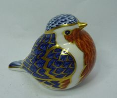 A Royal Crown Derby Robin paperweight, with gold stopper  Sold For: £25