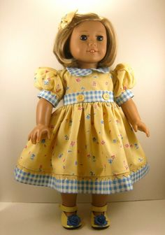 American Girl Doll Clothes 18 Inch Doll Dress Yellow and Blue Short Sleeved Dress with Matching Hair Bow. $22.00, via Etsy.
