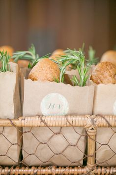Bread in paper bag with sprig of rosemary. Wedding logo on front. Could do in gold font. Know a good bakery?