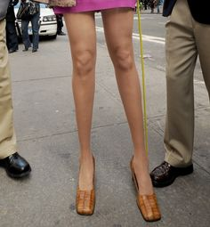 The Hottest Legs in History  At Length As the world record holder for longest gams, this woman's legs go on for days.