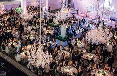 Twenty hanging crystal chandeliers illuminate the scene at dinner in the Charles Engelhard Court.