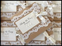 Rustic wedding invitation with lace and pearls.  Made by Handmade by Clare.  Competition winner in March 2017
