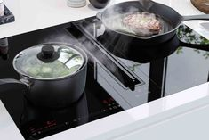 V-ZUG induction hobs with downdraft extractor
