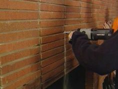 Installing a mantle Ina brick fireplace