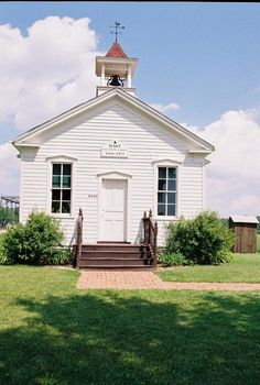 This Hart one room school house was built in the 1860's and rests in Frankenmuth, Michigan. Outside and to the righthand side, you'll find an outhouse.