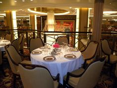 Google Image Result for http://0.tqn.com/d/cruises/1/0/T/k/5/Allure-of-the-Seas-9729.JPG Formal dinning room on the ship