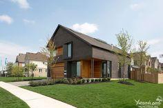 Современный двухэтажный дом с мансардой от студии Superkul