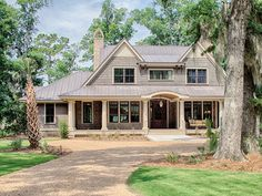 This plan has been designed for outdoor enjoyment, but is just as spacious and comfortable inside. The main level's open layout connects the kitchen, dining, and living areas to one another, all with access to the outdoor porches. The master suite occupie