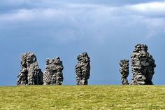 The Manpupuner rock formations are a set of 7 gigantic stone pillars located on a flat plateau, west of the Ural mountains in the Troitsko-Pechorsky District of the Komi Republic. Komi Republic, Volga Germans, Ural Mountains, Stone Pillars, Reserva Natural, Rock Formations, Ancient Aliens, Nature Reserve, Mother Earth