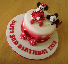 Minnie and mickey mouse cake.  Red airbrushed spots.