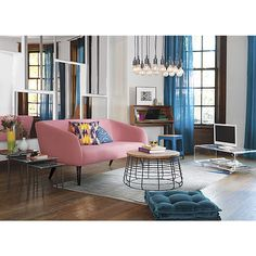 very cool space, colors play nicely off each other, and nothing is matched. Looks great (if you like pink sofas)
