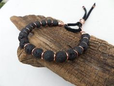 The way the lava stone and copper compliment each other, gives this bracelet a beautiful meditative, zen appearance that looks great alone or stacked with other bracelets.  This bracelet has been handmade from 8mm black lava stone beads and copper rings, that have been strung on strong, multi-strand, flexible wire for comfort, longevity and durability.  The black suede and hand forged copper sliding clasp is a unique feature that helps make this bracelet unique. The copper will naturally…