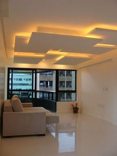 This light fixture demonstrates implied light because it illuminates this room without the use of any natural light. House Ceiling Design, Ceiling Design Living Room, Bedroom False Ceiling Design, False Ceiling Living Room, Ceiling Light Design, Home Room Design, Home Ceiling, Ceiling Decor, Home Interior Design