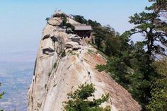 At the very top of the southern peak is a Taoist temple that was converted into a teahouse. Thousands of people climb the world's most dangerous path to end up at a teahouse.