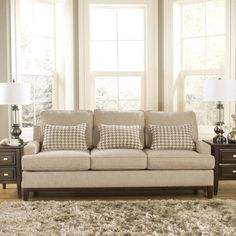 The Ashley Furniture Donella Sofa is super sophisticated. Covered in barley beige fabric, it features 3 extra cute houndstooth pillows accent pillows! With a cherry finish on block feet, it is simple to move around and clean. (Matching Loveseat may also be available.) Ashley Donella Beige Sofa | Weekends Only Furniture and Mattress
