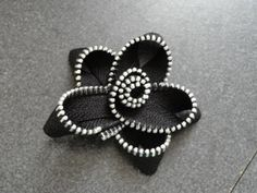 $7 Zipper Flowers in assorted colors. #Zipper #Flower #hairclip