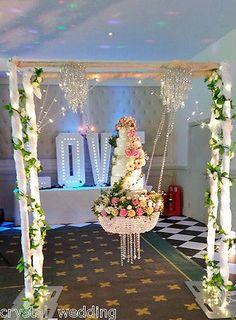 Stunning sparkling Crystal Chandelier suspended swing wedding cake stand