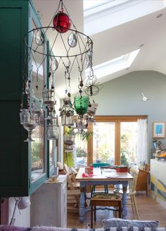 Frances & Dom's Handcrafted Home / Handmade chandelier with family and found treasures