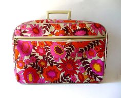 color of the week: PINK!    snazzy 60s floral suitcase from Alix