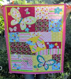 Beautiful layered butterfly quilt. I love the scattered layout idea of this quilt!
