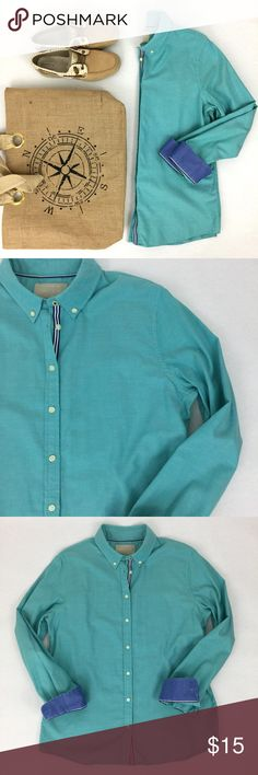 Banana Republic // Oxford Shirt Turquoise and blue, Banana Republic, Oxford shirt. This top has a preppy look and would be perfect for a day on the water. Complete your yacht look with Sperry Topsiders and floral print shorts. One minor issue, there is a light mark on the front (left side). See close up photo. Not a stain, appears to be a superficial flaw in the material. Bust 42in, Length 28in. 100% Cotton. Banana Republic Tops Button Down Shirts