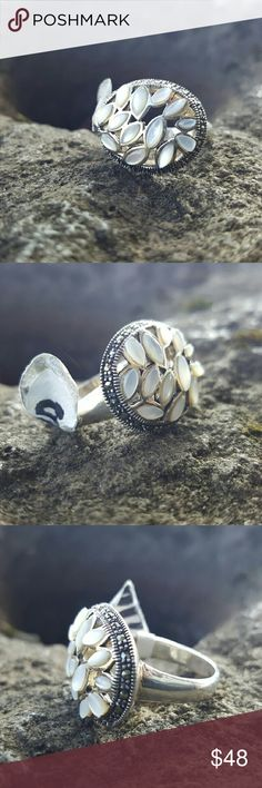 Blister pearl and marcasite ring Blister pearl set in handcrafted Artisan 925 sterling silver with marcasite surrounding the pearl. Size 8 Robin's Nest Jewels  Jewelry Rings