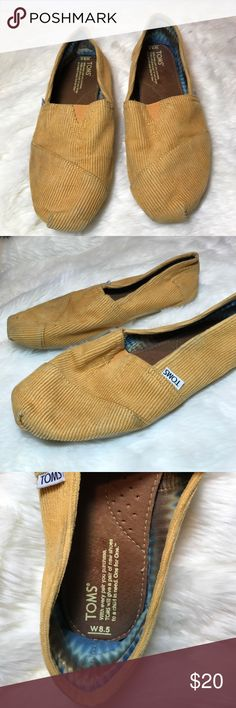 Mustard Yellow Corduroy TOMS Corduroy classic TOM slip-ones. Worn, but good condition. Superficial dirty spots. TOMS Shoes Flats & Loafers